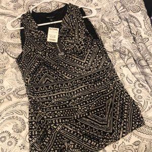 Sleeveless blouse   Black and beige.